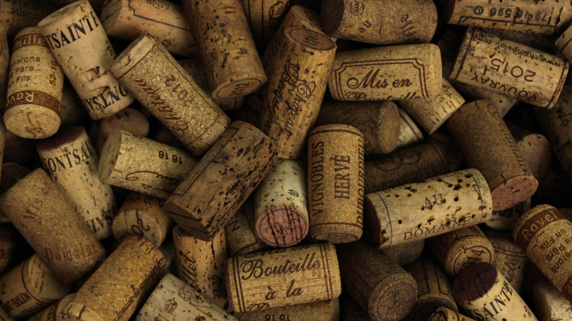 A bunch of wine corks mainly from the Bordeaux region