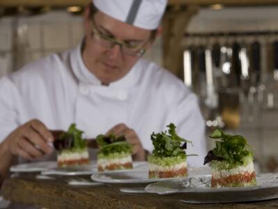 A chef preparing dish presentation