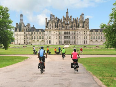 Cycling in front of the Château of Chambord in the Loire Valley