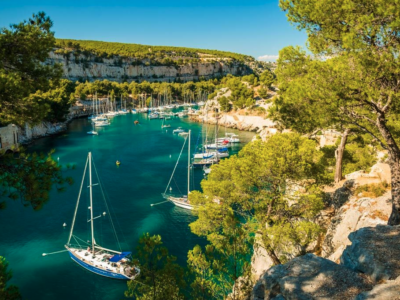Sailing boats moored in a calanques in the South of France