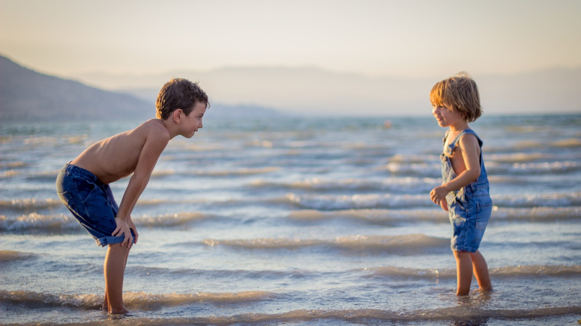 Two children playing in the water