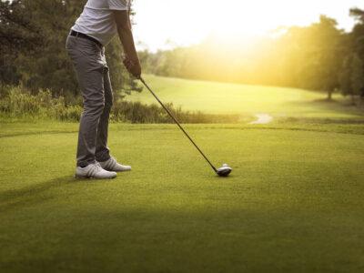 Golfer preparing to tee off