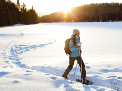 A lady walking with snowshoes in nature